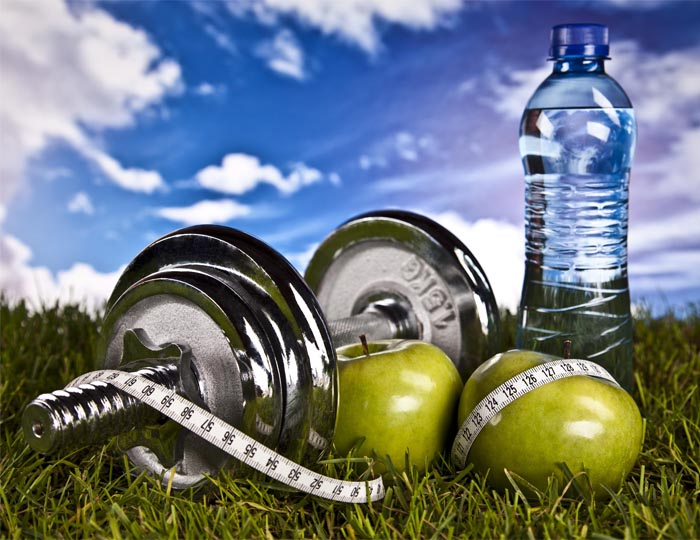 An image of Weights, Water and Apples, All parts of a healthy lifestyle.